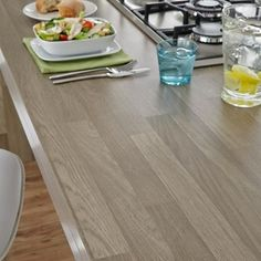 Complement your grey oak block effect worktop with this matching breakfast bar to create a stylish centrepiece to your kitchen. Grey Oak, Work Tops, Bamboo Cutting Board, Bar, Stylish, Create, Breakfast, Kitchen, Morning Coffee