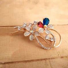 Beautiful Colored Stones Brooch in beautiful floral pattern.  Wear it on your western or indian dress to look beautiful. #modern #newarrivals #springqueen #brooches #festivefeel