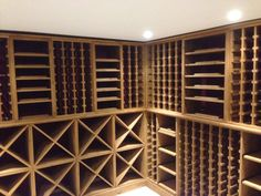 Bespoke solid pine wine racking with a medium oak stain, features individual bottle hole storage, case racks, cellar cubes, display areas and a handy work surfaces. All of the wine racking throughout was supplied with plinths by Wineware in the UK. Wine Racks Uk, Oak Wine Rack, Caves, Wine In The Woods, Wine Making Process, Barolo Wine, Wine Education, Wine Sale, Oak Stain