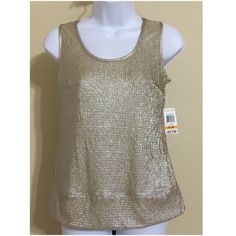 JM Collection Petites Blouse Size PS JM Collection Petites Women's Blouse Size PS Gold Color Sleeveless Shimmery In Silver Embossed Fabric Machine Washable 100% Polyester Armpit to Armpit Approx. 17 Inches Length From Rear Collar Approx. 21 Inches Shoulder Approx. 15 Inches New With Tag JM Collection Tops Blouses