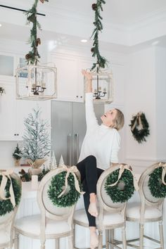 Easy holiday decor for your kitchen! There are so many ways that you can utilize wreaths in your home! My favorite is behind the kitchen stools. Front Door Christmas Decorations, Blue Christmas Decor, Classy Christmas, Farmhouse Christmas Decor, Noel Christmas, Easy Holiday Decorations, Christmas Ideas, Christmas Lights, Christmas Decor In Kitchen