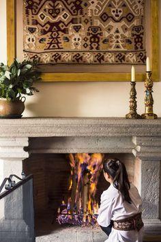 Lounge by the fireplace at  luxury botique hotel Inkaterra La Casona Hotel in Cusco, Peru