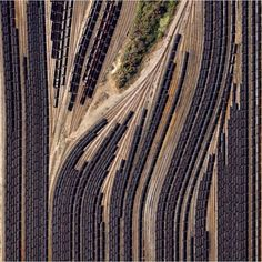 For Instagram's #whpabstract contest we've captured these swirling train cars filled with coal in Norfolk Virginia. Operated by the Norfolk Southern corporation Lamberts Point Pier 6 is the largest coal-loading station in the Northern Hemisphere and serves at the temporary depot for the companys fleet of 23000 coal cars. by dailyoverview