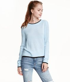 Light blue. Knit sweater in soft fabric with ribbing at neckline, cuffs, and hem. Slits at sides.