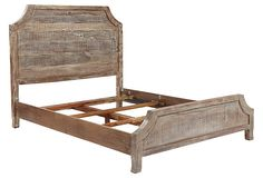 A wood bed can still have a feminine touch in the bedroom.