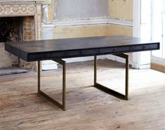 "The Cortes desk by Julian Chichester is wrapped in hand-dyed black vellum and is an elegant update of a midcentury Danish design. The steel base is gilded, and the four drawers are lined in sycamore. The desk measures 72"" w. x 35.5"" d. x 30"" h. www.julianchichester.com"