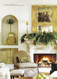"Houston, Texas, home for a family of six. ""Designer Pamela Pierce draped the stone mantel, salvaged from a house in Galveston, Texas, with abundant fir branches and green pears."" Interior design by Pamela Pierce, Pierce Designs and Associates. Photography by Tria Giovan. ""Tailor-Made Trimmings"" by Lydia Somerville. Southern Accents (November - December 2003)."