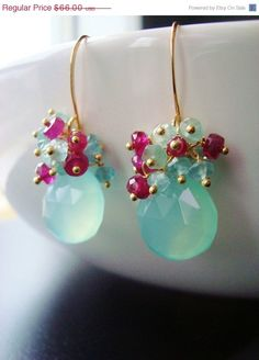 Again, pairing berry and gold colours with turquoise, although too much turquoise here for me.