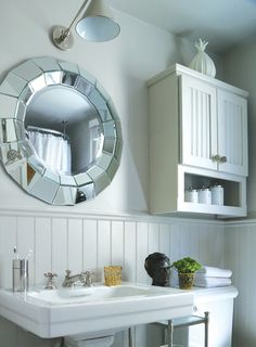 waterworks sink and circa lighting light fixture in a beautiful powder room