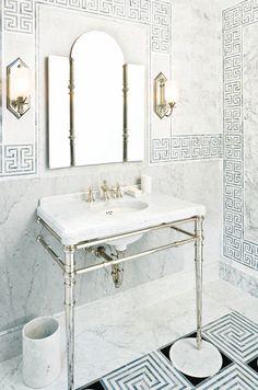 floor to ceiling ann sacks tile in a greek key pattern with vintage fixtures.  LOVE this bathroom!