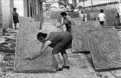"""Ferdinando Scianna, Women preparing the """"estratto"""", tomato sauce for winter, Bagheria, Sicily, Italy, 1976."""