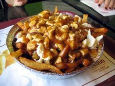 Poutine-Canadian staple.  Homemade crispy, salty fries, topped with cheese curds and then brown gravy.  Sounds AMAZING.
