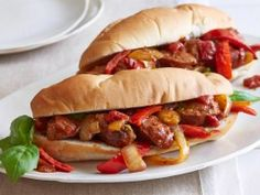 Sausage, Peppers and Onions  Giada intensifies the flavor of this classic lunch-counter combo by adding rich Marsala to her tomato sauce. To serve, hollow out Italian rolls and stuff them full of sweet sausages and sauce.