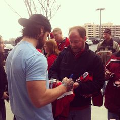 Mike Green signing autographs outside of Kettler Capitals Iceplex.