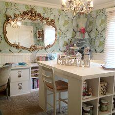 Love the table in the middle of the room with the space for storage on the sides...would have never thought to hang a mirror in my craft room...I like it!