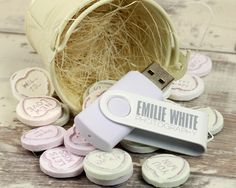 White custom flash drive with Valentine's Day candy.