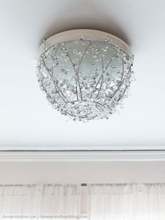 Update your old light fixture with this pretty (and easy!) DIY chandelier.
