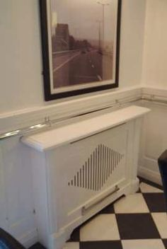 contemporary radiator cabinet design with the classical panelling : )x