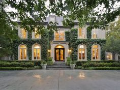 French- Ivy Home with Arched Windows