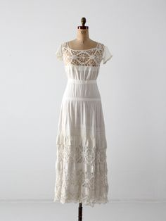 A stunning late Victorian era white dress underpinning. The white cotton dress features a crochet lace bodice with mesh lace cap sleeves. The petticoat skirt is tiered and has crochet lace, pin-tucks Vintage Outfits, Vintage Dresses, Victorian Outfits, Vintage Clothing, Edwardian Fashion, Vintage Fashion, Vintage Mode, Vintage Skirt, Trendy Dresses