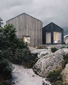 A rocky landscape and natural woods form a dreamy beach house #beachhouse #dreamhome