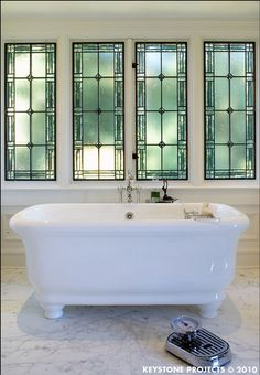 Dream bathroom - adore those windows and the modern footed bath... the styling with the scales in shot is a bit strange though, right?