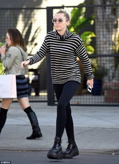 Quirky: The former child star showcased her trim physique in skintight black leggings, pai...