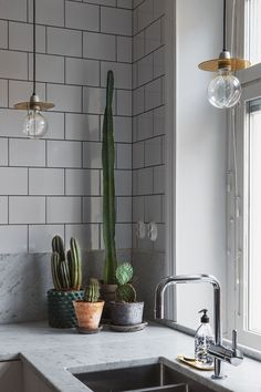 "marble with subway tiles is a nice ""opposites attracts"" kind of combo. The dark…"