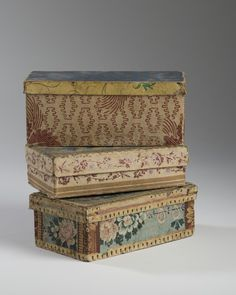 Antique wallpaper boxes~Image via North Bayshore Antiques