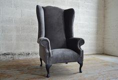 Modern British handmade Whittington deep buttoned Chesterfield Wing Chair, shown in Slate Grey velvet. High back. | Abode Sofas