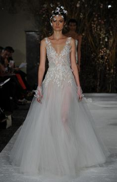 Sheer gown with plunging neckline, floral details and matching gloves | Mira Zwillinger Spring 2017 | https://www.theknot.com/content/mira-zwillinger-wedding-dresses-bridal-fashion-week-spring-2017