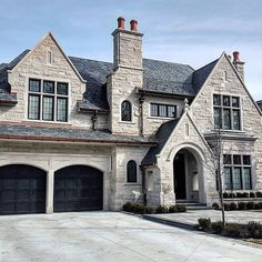 Black garage doors don't work for every home, but when they do they are a great distinctive conversation piece. They look great on this castle-like home! Black Garage Doors, French Exterior, Garage Door Design, Boho Home, Décor Boho, Dream House Exterior, Mansions Homes, Dream Home Design, French Country House