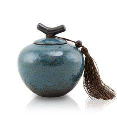 Luxurious, turquoise blue infant ceramic cremation urn hand crafted in northern China.