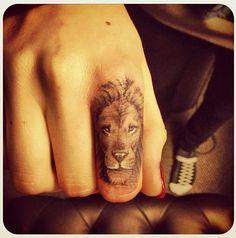 Lion finger tattoo