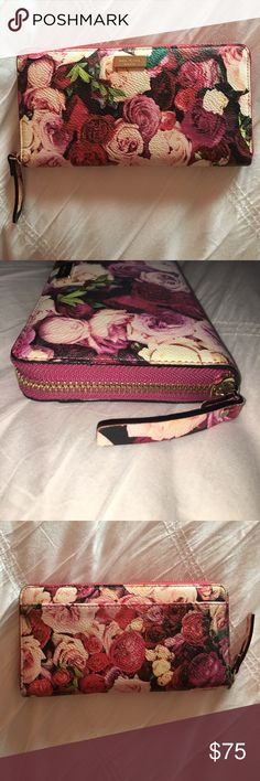 Kate Spade Leather Zip Wallet w/ Floral Print Kate Spade leather zip wallet with gorgeous rose print on front. Barely used - NO signs of wear. Get it while it lasts! kate spade Bags Wallets