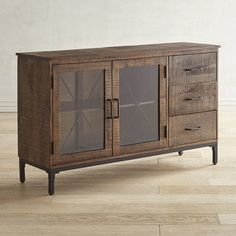 If you're a fan of the rustic look of reclaimed wood paired with industrial metal details, our Wyatt Collection is sure to make your must-have list. While our media cabinet has plenty of space behind its glass-front doors for electronics, it also has three side drawers to store DVDs, extra cables, remotes and more to keep everything in its place and clutter-free.