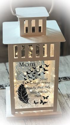 """MEMORIAL LANTERN. Durable white metal finish Measures 6x6"""" base x 12"""" tall 50 battery operated fairy lights INCLUDED Personalized with name of choice INCLUDED PLEASE INDICATE NAME TO BE ADDED IN NOTE TO SELLER AT PURCHASE Candy Christmas Decorations, Christmas Lanterns, Christmas Crafts, Memory Crafts, In Memory Gifts, Christmas In Heaven, Creation Deco, Sympathy Gifts, Diy Home Crafts"""