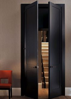 Nicky Dobree ------------------door trim matches door color instead of base color, door handles match door style well, black door works well for darker walls.