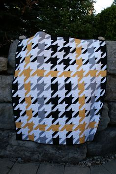 Plaid Houndstooth, pieced by Brandon, machine quilted by Pam
