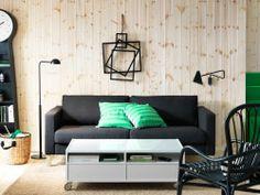 Black three-seat sofa, lighting and white coffee table on castors