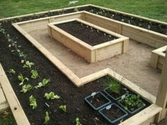 Raised bed garden. This is so practical yet very pretty to look at.