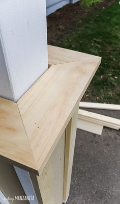 Use the miter saw to create 45 degree angles on the wood trim for the bottom porch of the DIY modern farmhouse porch post wraps. Learn how to build column wraps to add curb appeal to your front porch! Decor Style Home Decor Style Decor Tips Maintenance