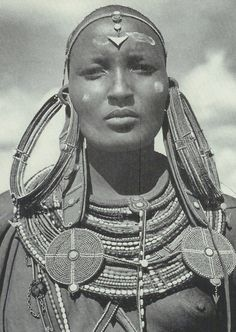 Vintage National Geographic Scans | Maasai woman in tradition earrings (each weighing over a pound) signifying that she's married.