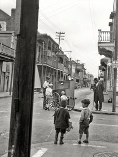 "Bourbon Street and Ursulines Avenue circa 1925. ""New Orleans organ grinder."" Nitrate negative by Arnold Genthe."