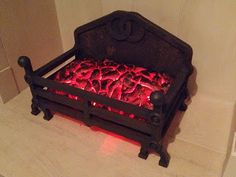 Fake coal fire with expanding foam  LEDs | A Penny Drops. I would make it harry potter themed, making it a talking fire with a face.