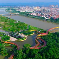 Yanweizhou Park in Jinhua, south-east China, is the winner of the Landscape of the Year 2015 award. Sitting at the mouth of three rivers, each over 100 metres wide, the park is covered in flood adapted native vegetation to create a natural water-resilient embankment. The park's pedestrian paths and pavilions are integrated with the planting terraces, connecting the city to the natural environment. It was designed by Turenscape International. Click above to see larger image.