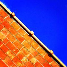 Blue Sky-Orange Bricks