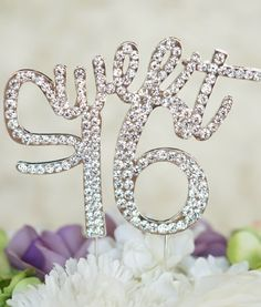 "This premium high-quality topper will be perfect for your special day! Be prepared for ""Oos and Ahhs"" at this classic special topper. - ""Sweet 16"" monogram silhouette cake topper in elegant & fun curs"