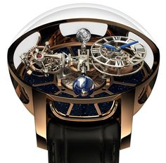 "Jacob & Co. Astronomia Tourbillon Baguette Watch For $1,015,000 - on aBlogtoWatch.com ""Last year in 2014, Jacob & Co. debuted a very interesting watch with an extravagant movement they called the Astronomia Tourbillon... The sheer complexity of the movement in the watch requires a lot of tweaking to make it work and years of effort. For 2015, however, it looks like the Jacob & Co. Astronomia Tourbillon is back with a new case design as well as a very much 'Jacob & Co...'"""