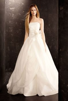 Brides.com: Wedding Dresses We Love For Under $1,000. Get the drama a ballgown offers combined with delicacy of a draped organza dress in this knockout gown.  Style VW351178, organza wedding dress with draped bodice, $928, White by Vera Wang available at David's Bridal  See more White by Vera Wang wedding dresses.